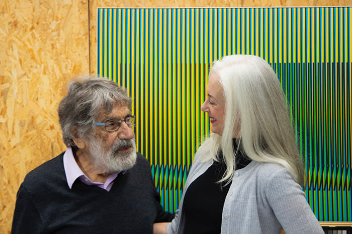 Artist, Carlos Cruz-Diez and Mary Rozell, Global Head of the UBS Art Collection and artist, in his studio.