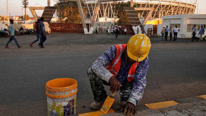 Workers are rushing to complete the Motera 110,000-seat cricket stadium in Ahmedabad before Mr Trump's arrival
