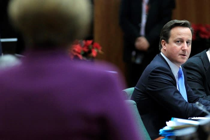 UK Prime Minister David Cameron glancing at Germany's Chancellor Merkel during a summit in December 2019. The two had clashed over proposed treaty changes. In the end, the 27 other member states decided to sidestep the UK