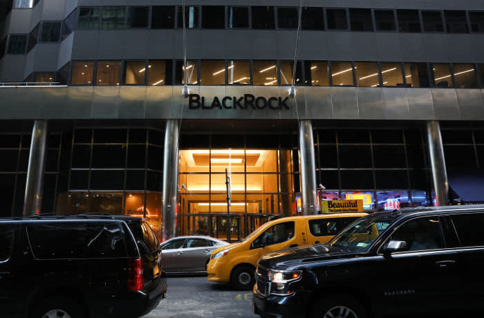 Vehicles pass in front of BlackRock Inc. headquarters in New York, U.S, on Wednesday, June 11, 2018. BlackRock Inc. is scheduled to release earnings figures on July 16. Photographer: Bess Adler/Bloomberg