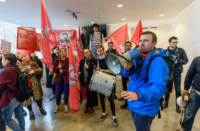 RMA727 London, UK. 14th February 2019.General Secretary of the IWGB, Jason Moyer-Lee speaks in the foyer of the Ben Pimlott Building, briefly occupied as the IWGB union and students launch their campaign for Goldmsiths, University of London, to directly employ its security officers. Currently they are employed by CIS Security Ltd on low pay and minimal conditions of service, and CIS routinely flouts its legal responsibilities on statutory sick pay and holidays. Credit: Peter Marshall/Alamy Live News