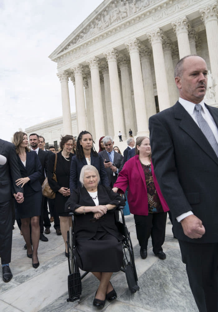 Aimee Stephens sits outside of the U.S. Supreme Court in Washington, D.C., U.S., on Tuesday, Oct. 8, 2019. Stephens wasfiredfrom her job as a funeral home director after telling the owner she was preparing to live openly as a woman. Photographer: Sarah Silbiger/Bloomberg