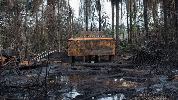 A view of an illegal oil refinery destroyed by members of the NNS Pathfinder of the Nigerian Navy forces is pictured on April 19, 2017 in the Niger Delta region near the city of Port Harcourt. NNS Pathfinder of the Nigerian Navy forces are cracking down on illegal oil refineries in the countrys oil heartland. / AFP PHOTO / STEFAN HEUNIS (Photo credit should read STEFAN HEUNIS/AFP via Getty Images)