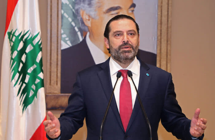 """In this handout picture provided by the Lebanese photo agency Dalati and Nohra, Lebanon's Prime Minister Saad Hariri announces the resignation of his governmentt in the capital Beirut on October 29, 2019, bowing to nearly two weeks of unprecedented nationwide protests. - Hariri's express and sombre televised address was met by cheers from crowds of protesters who have remained mobilised since October 17, crippling the country to press their demands. (Photo by - / DALATI AND NOHRA / AFP) / === RESTRICTED TO EDITORIAL USE - MANDATORY CREDIT """"AFP PHOTO / HO / DALATI AND NOHRA"""" - NO MARKETING - NO ADVERTISING CAMPAIGNS - DISTRIBUTED AS A SERVICE TO CLIENTS === (Photo by -/DALATI AND NOHRA/AFP via Getty Images)"""