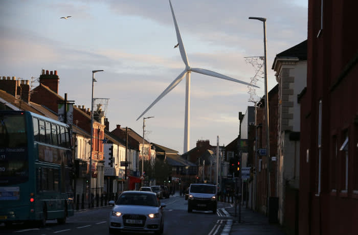 """A general view shows a wind turbine over the town of Blyth in northeast England on December 13, 2019 the day after the former mining town voted in a Conservative MP for the first time in its history contributing to the Tory party's landslide victory. - UK Prime Minister and Conservative leader Boris Johnson proclaimed a political """"earthquake"""" Friday after his thumping election victory cleared Britain's way to finally leave the European Union after years of damaging deadlock over Brexit. To secure the landslide victory the Conservative Party took a swath of seats from the Labour Party's traditional heartlands in the north and the midlands bringing about Labour's worst election defeat since 1935. One of the first results emphasised Labour's woes, with the former safe seat of Blyth Valley in a one-time mining area in northeastern England voting Tory for the first time in its history. (Photo by Lindsey Parnaby / AFP) (Photo by LINDSEY PARNABY/AFP via Getty Images)"""