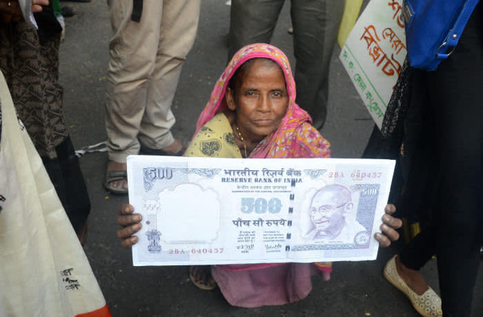 Indian Congress activists protesting against the central government decision on the eve of first anniversary of demonetisation in Kolkata, India on Wednesday , 8th November , 2017. Indian Prime Minister Narendra Modi announces to ban 1,000 and 500-rupee notes last year. Opposition parties in India have called for street protests to mark one year since the government of Prime Minister Narendra Modi banned high denomination banknotes in a stated attempt to target undeclared