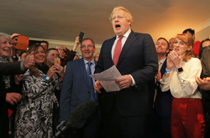 Britain's Prime Minister Boris Johnson speaks to supporters on a visit to meet newly elected Conservative party MP for Sedgefield, Paul Howell at Sedgefield Cricket Club in County Durham, north east England on December 14, 2019, following his Conservative party's general election victory. - Prime Minister Boris Johnson called on Britons to put years of bitter divisions over the country's EU membership behind them as he vowed to use his resounding election victory to finally deliver Brexit next month. (Photo by Lindsey Parnaby / POOL / AFP) (Photo by LINDSEY PARNABY/POOL/AFP via Getty Images)