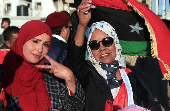 Libyans wave their national flag as they take part in a celebration marking the Libyan revolution, which toppled strongman Moamer Kadhafi, in Benghazi on February 17, 2020. (Photo by Abdullah DOMA / AFP) (Photo by ABDULLAH DOMA/AFP via Getty Images)