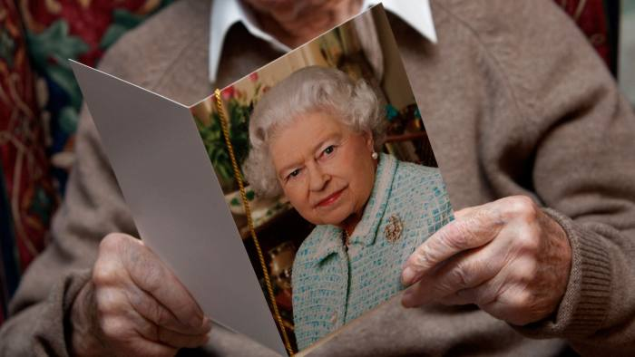 BWNH4C A 100-year-old man pictured on his birthday holding his telegram from the Queen, London, UK.