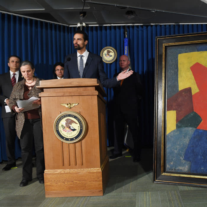 Paulo Abrao Pires Junior, Brazil's National Secretary of Justice, speaks at a ceremony to return a painting by Serge Poliakoffcalled Composition abstraite (Abstract composition) to Brazil, on May 9, 2014 at the US Attorney's office in New York. This and other artworks were part of a collection acquired by Brazilian Edemar Cid Ferreira, founder and former president of Banco Santos and were suspected to be smuggled into the US as part of a money laundering scheme. AFP PHOTO/Stan HONDA (Photo credit should read STAN HONDA/AFP via Getty Images)