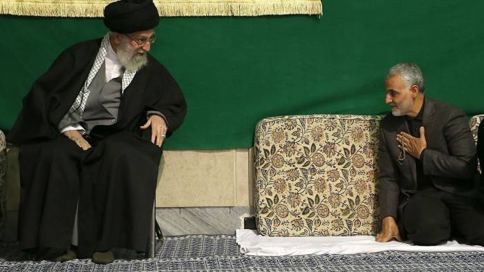 (FILES) This file handout photo released on March 27, 2015 by the official website of the Centre for Preserving and Publishing the Works of Iran's supreme leader Ayatollah Ali Khamenei, shows him (L) with the commander of the Iranian Revolutionary Guard's Quds Force, Gen. Qassem Soleimani, attending a religious ceremony in Tehran to commemorate the anniversary of the death of the daughter of Prophet Mohammed. - Top Iranian commander Qasem Soleimani was killed in a US strike on Baghdad's international airport on January 3, 2020, Iraq's powerful Hashed al-Shaabi paramilitary force has said, in a dramatic escalation of tensions between Washington and Tehran. (Photo by HO / KHAMENEI.IR / AFP) (Photo by HO/KHAMENEI.IR/AFP via Getty Images)