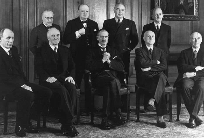 UNITED KINGDOM - NOVEMBER 15: The Conservative government of 1939. Back row, from left to right: Sir Kingsley Wood, Winston Churchill, Leslie Hore-Belisha and Lord Hankey. Front row, from left to right: Lord Halifax, Sir John Simon, Prime Minister Neville Chamberlain, Sir Samuel Hoare and Lord Chatfield. Chamberlain was Prime Minister until May 1940, when Churchill formed a coalition government with him at its head. (Photo by Manchester Daily Express/SSPL/Getty Images)