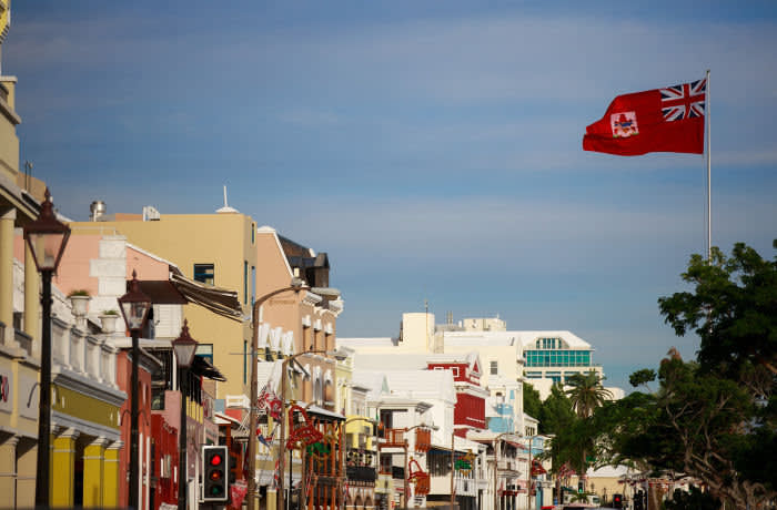 HAMILTON, BERMUDA - NOVEMBER 8: The flag of Bermuda flies along the commercial and retail district on Front Street, November 8, 2017 in Hamilton, Bermuda. In series of leaks made public by the International Consortium of Investigative Journalists, the Paradise Papers shed light on the trillions of dollars that move through offshore tax havens. (Drew Angerer/Getty Images)