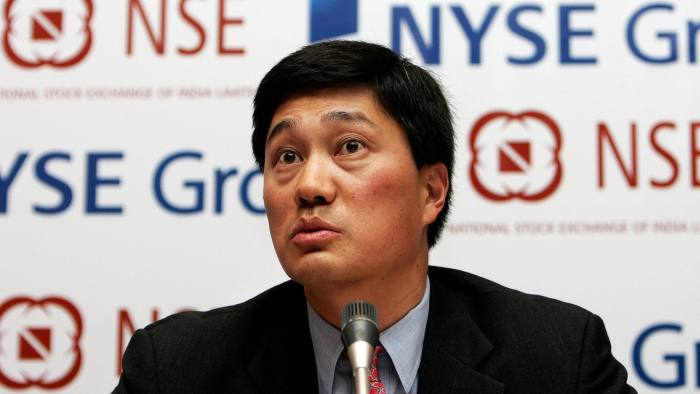 New Delhi, INDIA: Chief Financial Officer and Executive Vice-President of the New York Stock Exchange (NYSE) Group, Nelson Chai, addresses a media conference in New Delhi, 10 January 2007. NYSE Group today announced that it has signed a definitive agreement to acquire a 5% equity position in the Indian National Stock Exchange, the maximum investment permitted by a foreign investor. AFP PHOTO/ MANAN VATSYAYANA (Photo credit should read MANAN VATSYAYANA/AFP/Getty Images)