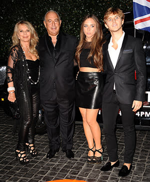 Philip Green with (from left) his wife Tina and children Chloe and Brandon at the Topshop