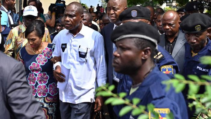 Opposition presidential candidate in the Democratic Republic of Congo Martin Fayulu (2ndL) walks with his wife, Esther, outside the constitutional court in the capital, Kinshasa on January 12, 2019, as he filed his appeal to impose a recount of the votes in the presidential election following a suspicion of fraud. - The outcome of DR Congo's tempestuous presidential election appeared to be headed for the courts on January 11 after the poll's runner-up said he would demand a recount. Martin Fayulu, an opposition candidate tipped by pollsters as the likely winner of the December 30 vote and who came in a close second, dismissed the result and announced he will challenge the outcome before the Constitutional Court. (Photo by TONY KARUMBA / AFP)TONY KARUMBA/AFP/Getty Images