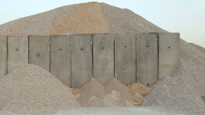 Sand piles over a concrete wall in a construction site near Beil in Beirut, Lebanon May 3, 2016. REUTERS/Alia Haju - S1BETBYZOKAB