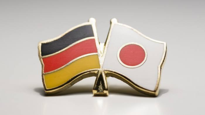 BERLIN, GERMANY - JANUARY 16: A pin displaying the German and the Japanese national flags is pictured on January 16, 2014 in Berlin, Germany. (Photo Illustration by Thomas Trutschel/Photothek via Getty Images)
