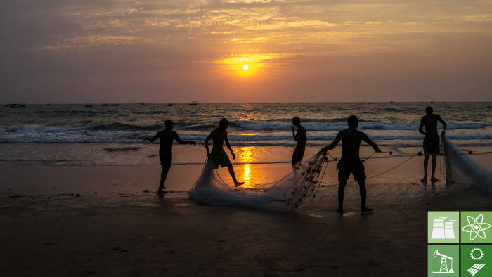 Local fisherman pack a fishing net as the sun sets in Goa, India. Photograph: Sanjit Das/Bloomberg