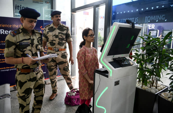A passenger stands as she registers her personal details at a facial recognition counter at the Rajiv Gandhi International Airport in Hyderabad, on July 26, 2019. (Photo by NOAH SEELAM / AFP) (Photo credit should read NOAH SEELAM/AFP via Getty Images)