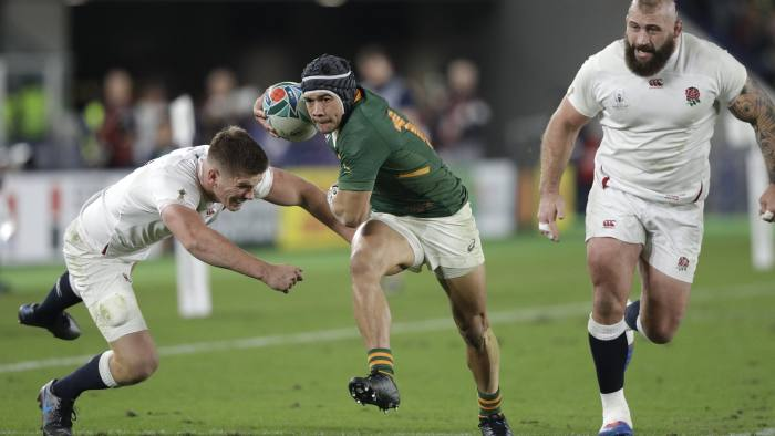 South Africa's Cheslin Kolbe breaks past England's Owen Farrell, left, and Joe Marler to score his side's second try during the Rugby World Cup final at International Yokohama Stadium between England and South Africa in Yokohama, Japan, Saturday, Nov. 2, 2019. (AP Photo/Mark Baker)