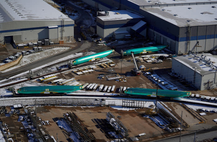 FILE PHOTO: Airplane fuselages bound for Boeing's 737 Max production facility await shipment on rail sidings at their top supplier, Spirit AeroSystems Holdings Inc, in Wichita, Kansas, U.S. December 17, 2019. REUTERS/Nick Oxford/File Photo