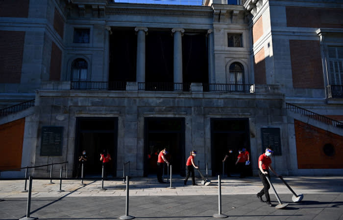 Employees place retractable belts outside The Prado Museum in Madrid, on June 6, 2020 as lockdown measures are eased during the novel coronavirus COVID-19 pandemic. - Museums are reopening in the Spanish capital with new security measures in place after a three-month closure due to the coronavirus health crisis. (Photo by Gabriel BOUYS / AFP) (Photo by GABRIEL BOUYS/AFP via Getty Images)