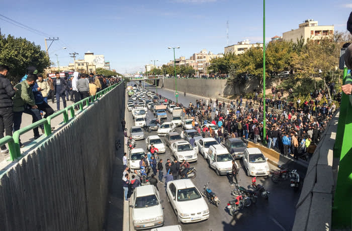 Iranian protesters block a road during a demonstration against an increase in gasoline prices in the central city of Isfahan, on November 16, 2019. - One person was killed and others injured in protests across Iran, hours after a surprise decision to increase petrol prices by 50 percent for the first 60 litres and 300 percent for anything above that each month, and impose rationing. Authorities said the move was aimed at helping needy citizens, and expected to generate 300 trillion rials ($2.55 billion) per annum. (Photo by - / AFP) (Photo by -/AFP via Getty Images)