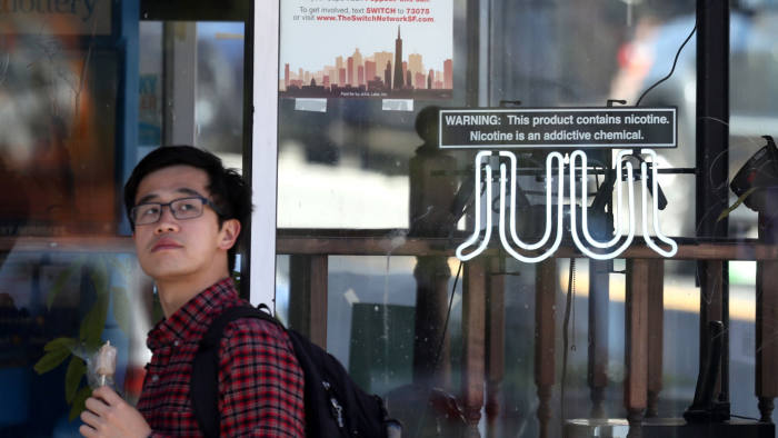 SAN FRANCISCO, CALIFORNIA - JUNE 25: A pedestrian walks by a neon sign advertising Juul e-cigarettes on June 25, 2019 in San Francisco, California. The San Francisco Board of Supervisors voted unanimously, 11-0, to be the first city in the United States to ban e-cigarettes, nicotine pods and devices that have not been approved by the Food and Drug Administration. (Photo by Justin Sullivan/Getty Images)