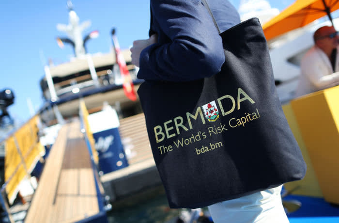 A visitor carries a Bermuda Business Development Agency (BDA) tote bag during the Monaco Yacht Show (MYS) in Port Hercules, Monaco, on Wednesday, Sept. 28, 2016. Over 125 of the world's most luxurious yachts will be displayed in Port Hercules during the 26th MYS which runs from Sept. 28 – Oct. 1. Photographer: Chris Ratcliffe/Bloomberg