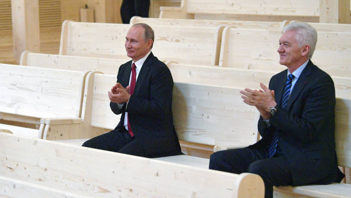 Russian President Vladimir Putin, left, applauds as he visits a new concert hall of the Mariinsky Theater in Repino outside St. Petersburg, Russia, Saturday, June 3, 2017. At right, Russian tycoon, Volga Group founder Gennady Timchenko. (Alexei Druzhinin/Sputnik, Kremlin Pool Photo via AP)