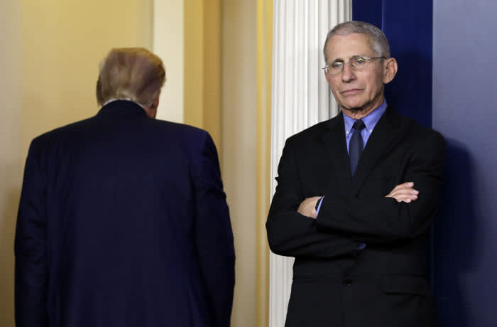 Mandatory Credit: Photo by Yuri Gripas/POOL/EPA-EFE/Shutterstock (10595000an) Director of the National Institute of Allergy and Infectious Diseases Dr. Anthony Fauci reacts as US President Donald J. Trump leaves after his press briefing on the Coronavirus COVID-19 pandemic with members of the Coronavirus Task Force at the White House in Washington, DC, USA, 26 March 2020. White House Coronavirus Task Force press briefing, Washington, USA - 26 Mar 2020