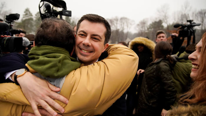 Pete Buttigieg, Democratic presidential candidate and former South Bend, Indiana mayor hugs a supporter as he drops by a polling location on primary day in Nashua, New Hampshire, U.S., February 11, 2020. REUTERS/Eric Thayer