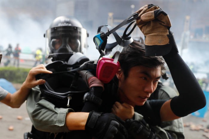 A protester is detained by riot police while attempting to leave the campus of Hong Kong Polytechnic University (PolyU) during clashes with police in Hong Kong, China November 18, 2019. REUTERS/Thomas Peter