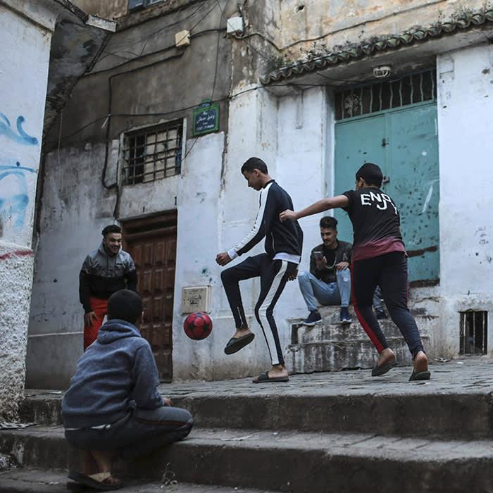 Children play football in Kasbah of Algiers, a UNESCO world heritage site, Algeria, Thursday, April 11, 2019. (AP Photo/Mosa'ab Elshamy)