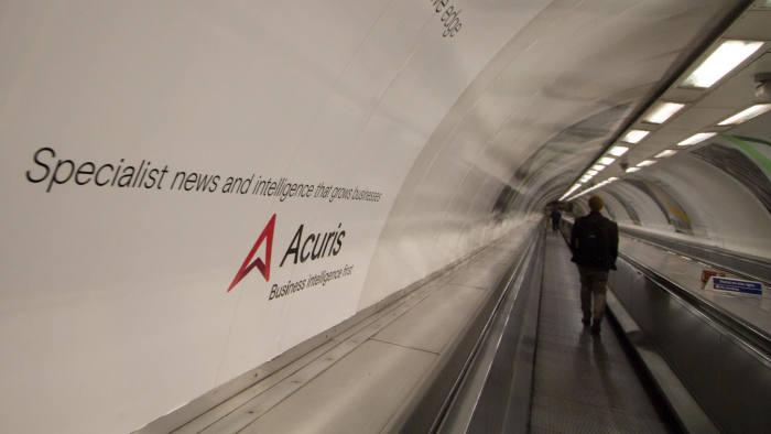 KDA89X Acuris advert on London underground tube network
