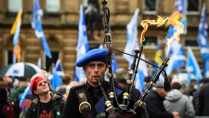 A pro-independence supporter plays the bagpipes at a rally calling for Scottish independence in Glasgow in November
