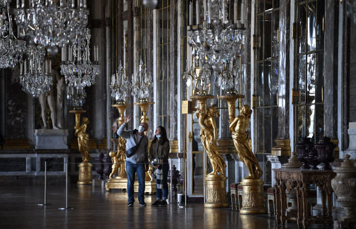People visit the Galerie des Glaces (Hall of Mirrors) in the French landmark Chateau de Versailles (Palace of Versailles) near Paris, for its reopening day on June 6, 2020 after weeks of closure following the lockdown measures taken in France to curb the spread of the COVID-19 disease caused by the novel coronavirus. (Photo by Anne-Christine POUJOULAT / AFP) (Photo by ANNE-CHRISTINE POUJOULAT/AFP via Getty Images)