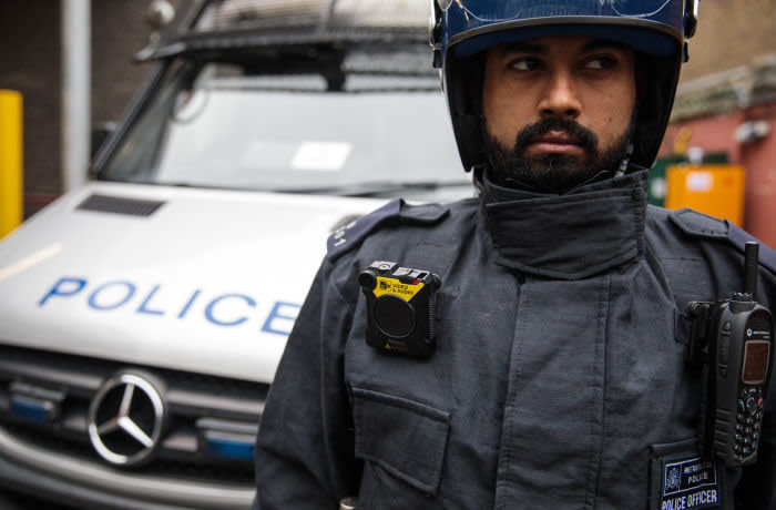 LONDON, ENGLAND - JANUARY 25: A body-worn camera (BWC) is pictured on the uniform of PC Mohammed Azir at Brixton Police Station on January 25, 2017 in London, England. The Metropolitan Police are rolling out the use of body-worn cameras which are able to record incidents and are thought to reduce the number of complaints against police officers. (Photo by Jack Taylor/Getty Images)