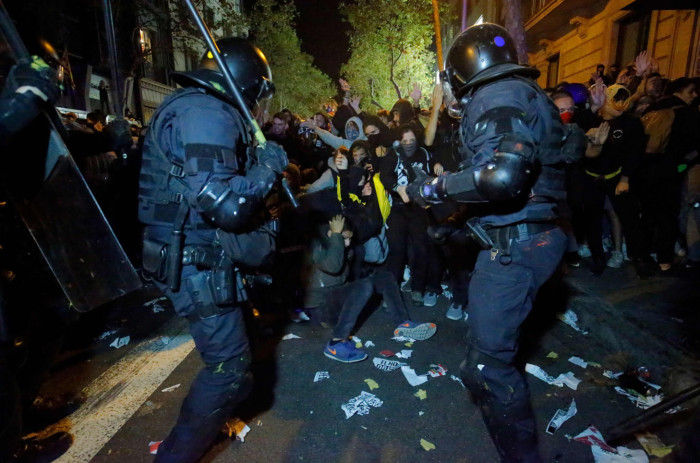 TOPSHOT - Protesters clash with Catalan regional police 'Mossos D'Esquadra' officers during a protest in front of the Spanish Government delegations in Barcelona on October 15, 2019, as Catalonia geared up for more upheaval a day after thousands of pro-independence activists stormed Barcelona airport in an angry response to Spain's jailing of nine of its leaders following a failed secession bid. (Photo by Pau Barrena / AFP) (Photo by PAU BARRENA/AFP via Getty Images)