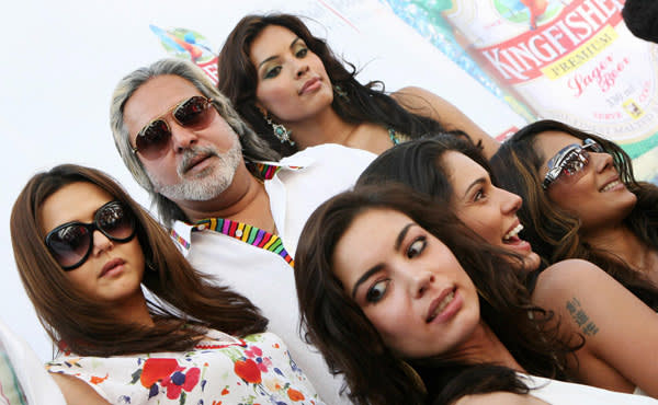 Vijay Mallya poses with actresses and models at the launch of his Kingfisher calendar in 2007
