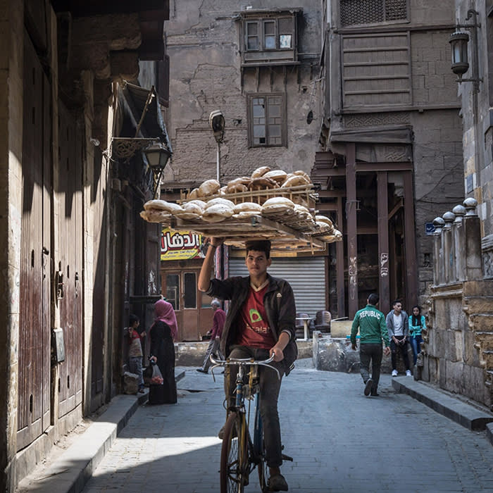 A young man delivers bread near the Hussein area of Cairo, March 31, 2018