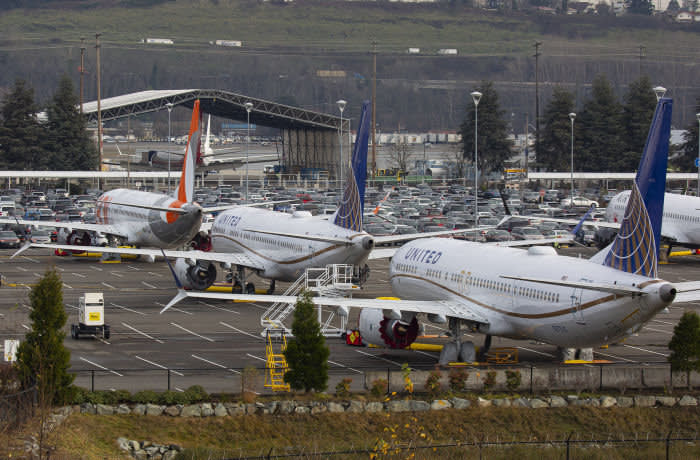 Grounded Boeing Co. 737 Max airplanes are seen in a parking lot near Boeing Field in Seattle, Washington, U.S., on Tuesday, Dec. 17, 2019. Boeingplans to halt production of its grounded 737 Max in January, a move that will deepen the crisis engulfing the planemaker, complicate its eventual recovery and ripple through the U.S. economy. Photographer: David Ryder/Bloomberg