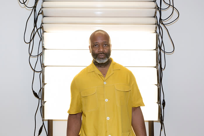 Theaster Gates in front of his work 'Bathroom Believer' (2018)