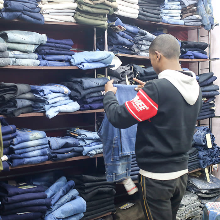 Islam organises clothes at a shop for casual clothes in downtown Cairo where he works part time, December 15, 2019. Photo/Asmaa Waguih