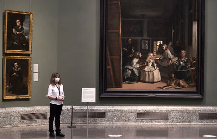 MADRID, SPAIN - JUNE 04: A museum worker wearing a face mask is seen next to Velazquez's 'Las Meninas' painting at the El Prado Museum during a press preview before its reopening to the public, during the coronavirus (COVID-19) pandemic on June 04, 2020 in Madrid, Spain. Spain has largely ended the lockdown it imposed to curb the spread of Covid-19, which caused the death of more than 27,000 people across the country. (Photo by Carlos Alvarez/Getty Images)