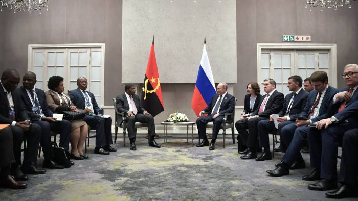 Russian President Vladimir Putin (R) meets with Angola's President Joao Lourenco on the sidelines of the 10th BRICS summit on July 26, 2018 in Johannesburg, South Africa. (Photo by Alexey NIKOLSKY / SPUTNIK / AFP) (Photo credit should read ALEXEY NIKOLSKY/AFP/Getty Images)