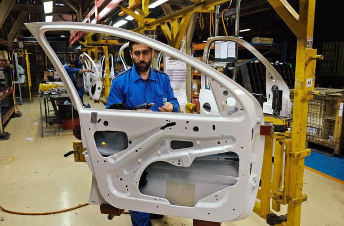 The production line in Iran Khodro Car FactoryIran Khodro Car Factory. Photo by Kaveh Kazemi