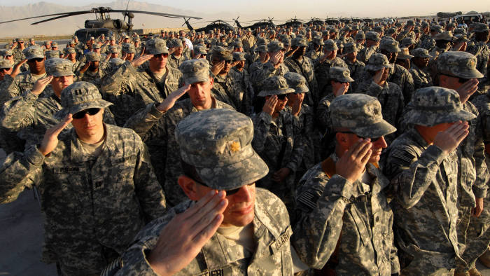 (FILES) In this file photo taken on September 12, 2006 US soldiers salute during a ceremony at Bagram air base, 50 kms north of Kabul, 11 September 2006 in remembrance of the victims of the 11 September 2001 terror attacks in New York and Washington. - The United States signed a landmark deal with the Taliban on February 29, 2020 laying out a timetable for a full troop withdrawal from Afghanistan within 14 months as it seeks an exit from its longest-ever war. (Photo by Shah MARAI / AFP) (Photo by SHAH MARAI/AFP via Getty Images)