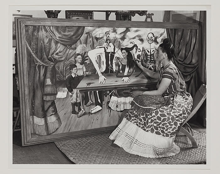 3713201 Frida Kahlo Putting Finishing Touches on One of Her Paintings, c.1940 (gelatin silver print) by Silberstein, Bernard (1905-99); Detroit Institute of Arts, USA; (add.info.: Frida Kahlo (1907-54) Mexican artist At work on 'The Wounded Table', a now lost work); Gift of the Artist; PERMISSION REQUIRED FOR NON EDITORIAL USAGE; RESTRICTIONS MAY APPLY FOR COMMERCIAL USE - PLEASE CONTACT US; American, in copyright. PLEASE NOTE: This image is protected by artist\'s copyright which needs to be cleared by you. If you require assistance in clearing permission we will be pleased to help you. In addition, we work with the owner of the image to clear permission. If you wish to reproduce this image, please inform us so we can clear permission for you.